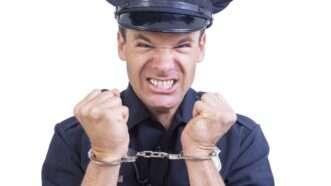 handcuffedpolice_1161x653