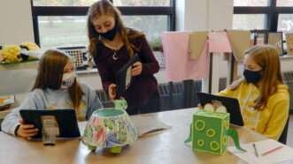 masked-girls-in-school-Newscom
