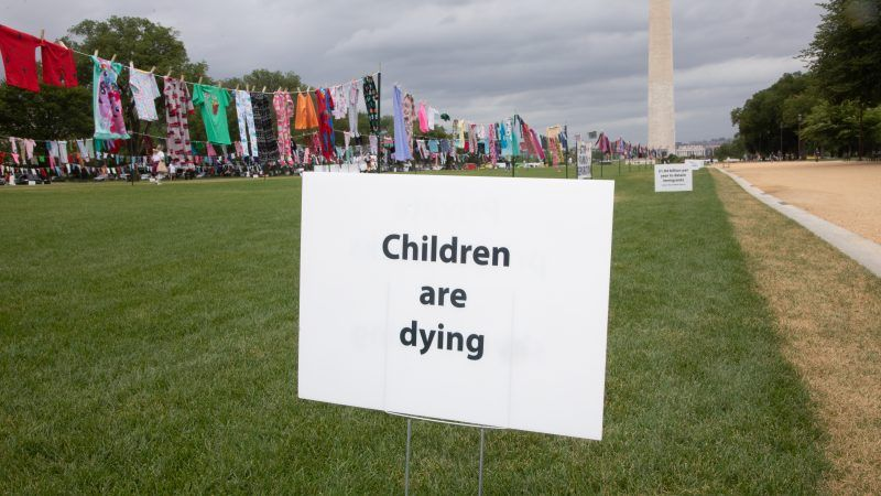 children-are-dying-sign-protest