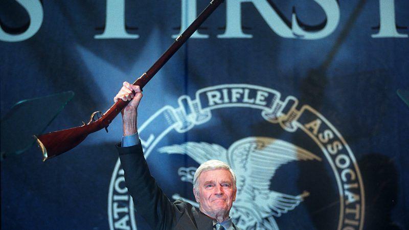 Charlton-Heston-lifting-rifle-Newscom
