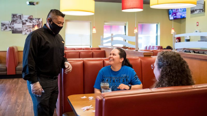 Denny's manager talking to customers in Lake Jackson, Texas, on Sunday May 3