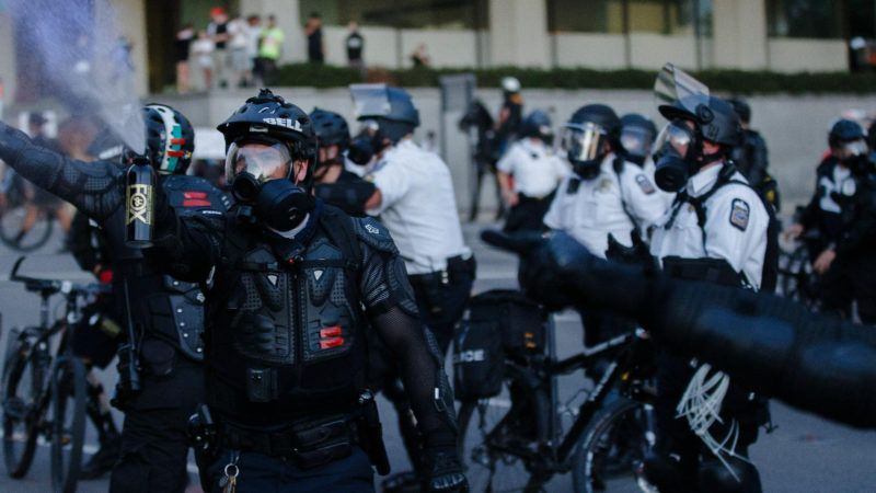 Columbus, Ohio, police officers use pepper spray on protesters near City Hall on May 29, 2020