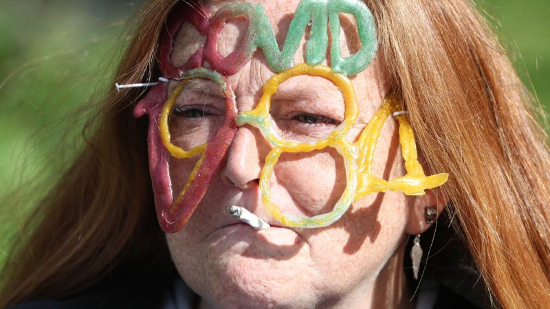 Protester in Scotland with COVID-1984 in gummies on her face