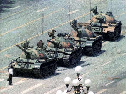 tiananmen square martyr standing in front of a tank