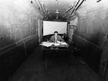 John Cage writes in a baggage car during the Avant Garde Festival in New York City, December 1973