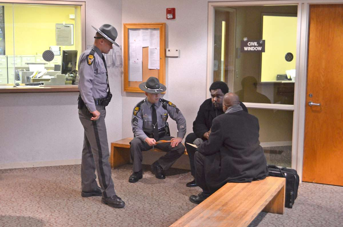 Norman Gurley meets with his attorney and Ohio state troopers