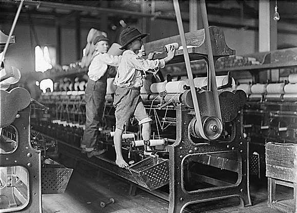 Children working in an American factory in the early 1900s.
