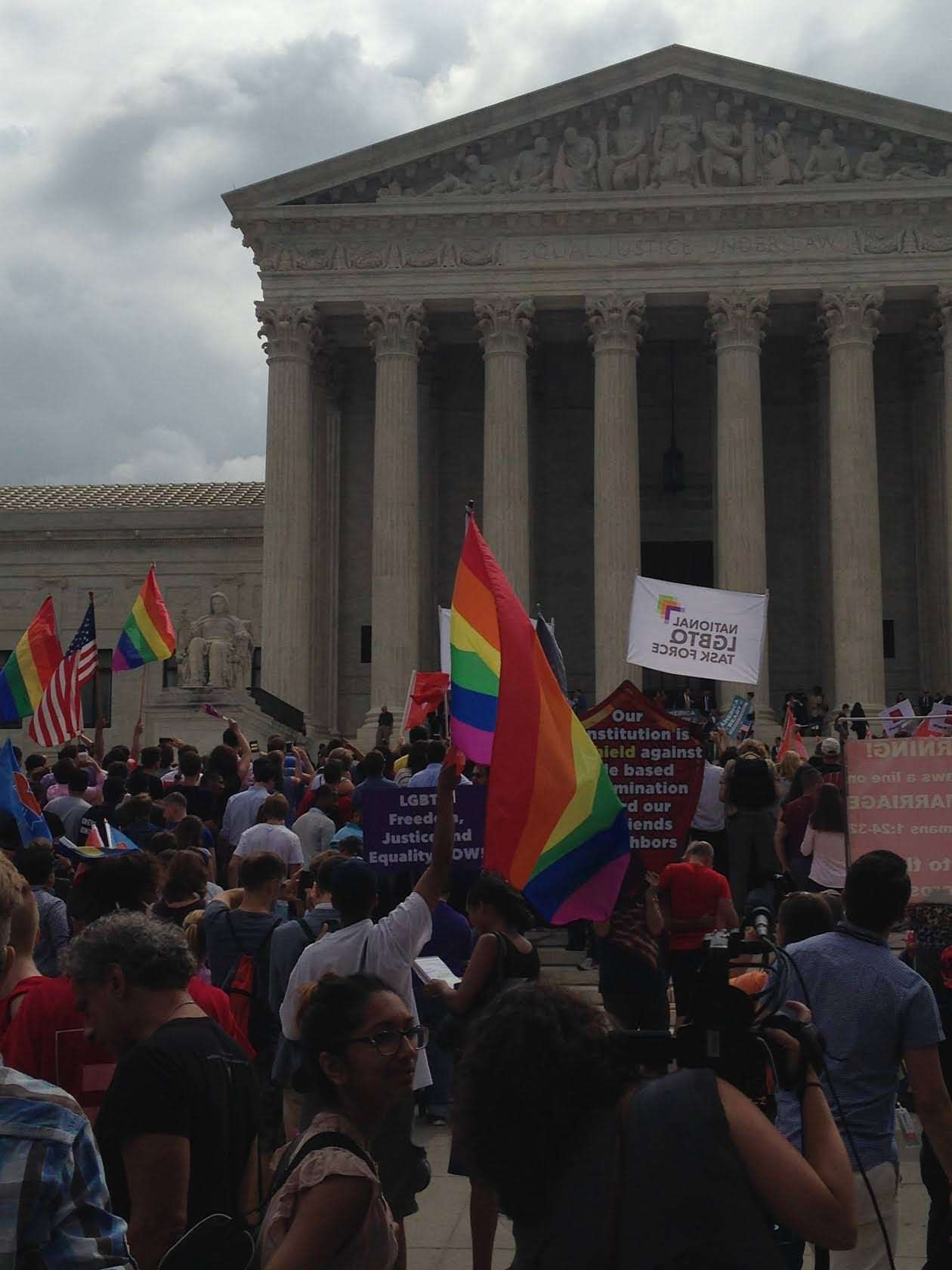 People rally outside the Supreme Court after SCOTUS handed down its gay marriage decision
