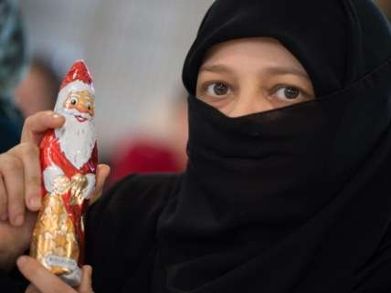 Syrian refugee with Christmas Chocolate