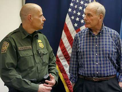 Secretary John Kelly pictured with a Customs and Border Patrol Officer