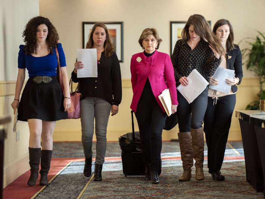 Lawyer Gloria Allred walks with several of the students behind a 2013 Title IX complaint filed with the Office for Civil Rights against the University of Connecticut