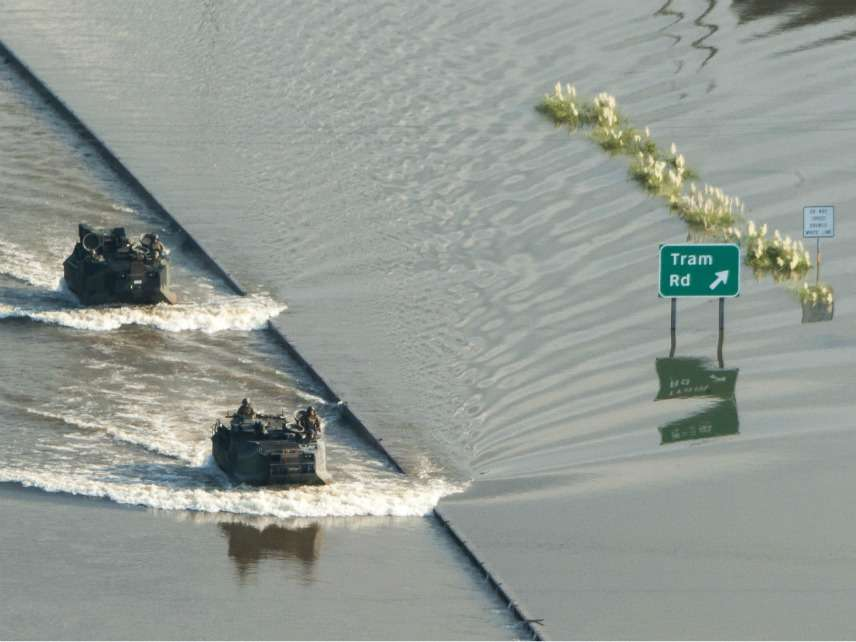 U.S. Marine Corps Assualt Amphibian Vehicles move through Hurricane Harvey flooded areas to north of Beaumont, Texas