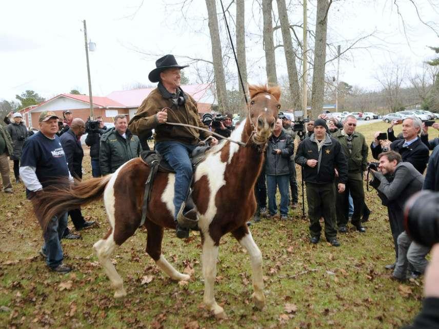 Roy Moore on horseback