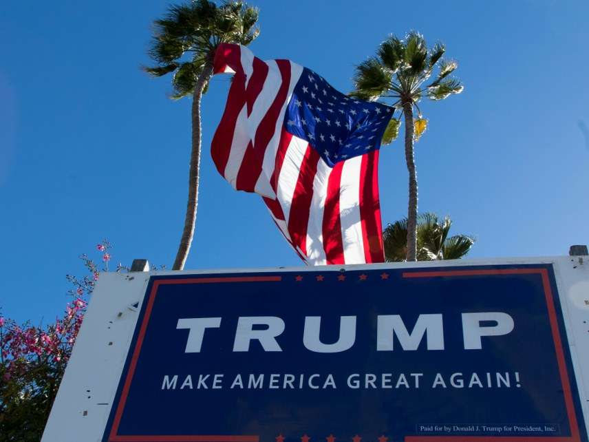 Flag and Trump sign