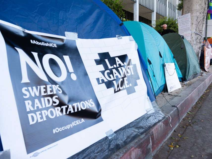 ICE raid protest signs