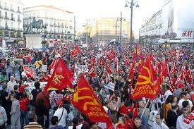 Spanish protesters with hammer and sickle flags.
