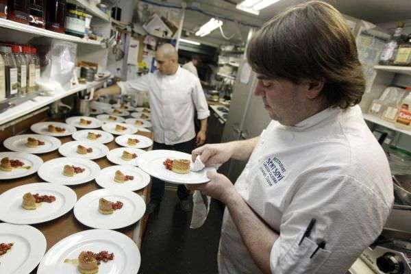 Foie gras is prepared for service at a California restaurant.