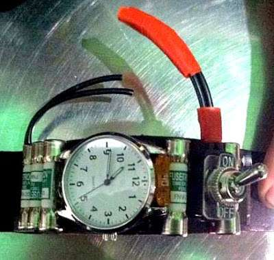 A watch with fuses, wires, and a toggle switch.