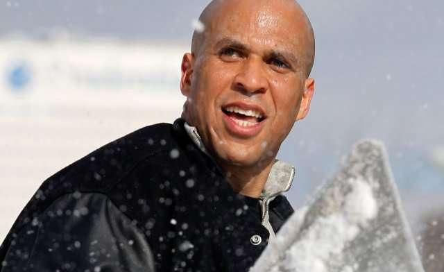 Cory Booker shoveling snow