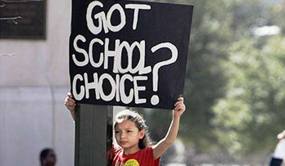 Girl holding a sign for school choice