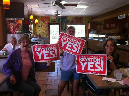People holding signs in support of the Keystone pipeline