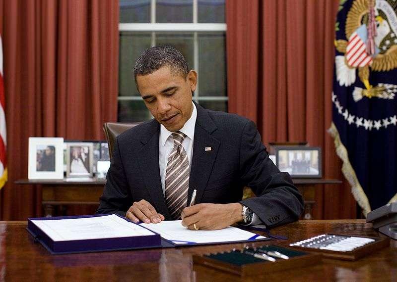 obama signing documents