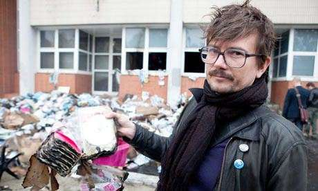 From their previous firebombing. This cartoonist, Luz, survived today's attack because he overslept.