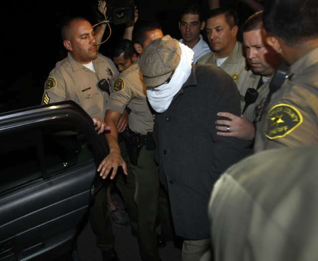 Helluva perp walk for a probation violation. ||| Allen J. Schaben / Los Angeles Times