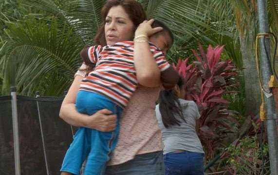 Nora with a child who has been affected by deportation