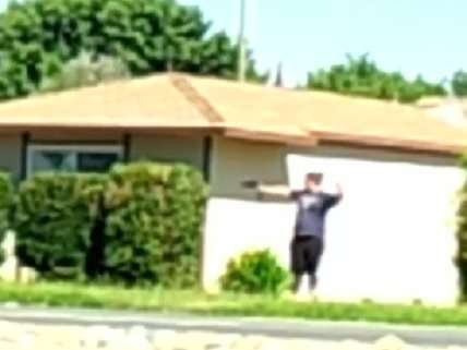 Woman brandishing power drill before being shot by cops