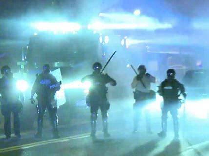 Ferguson police within tear gas