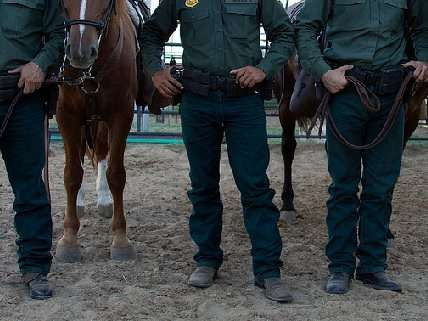 Border patrol agents with horses