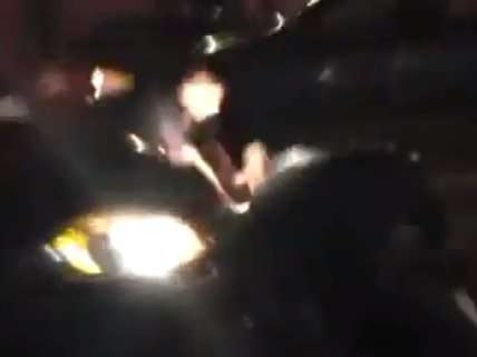 screen cap of NYPD brutality