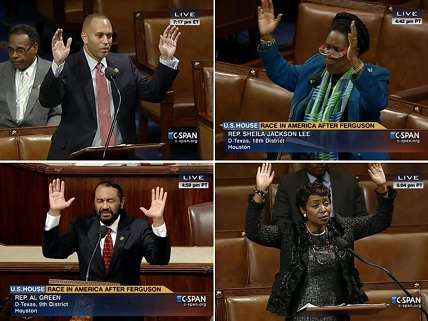 Four members of Congress with hands up