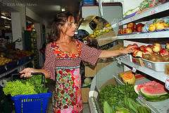Woman shopping for produce.