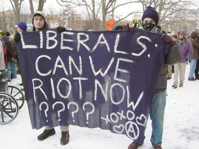 Black bloc demonstrators at Malcolm X Park during the January 20, 2005, counter-inaugural protest. Photo taken January 20, 2005, by Ben Schumin. Permission is granted to copy, distribute and/or modify this document under the terms of the GNU Free Documentation License, Version 1.2 or any later version published by the Free Software Foundation; with no Invariant Sections, no Front-Cover Texts, and no Back-Cover Texts. Hmm…it don't say nothin' 'bout no *alt*-texts.