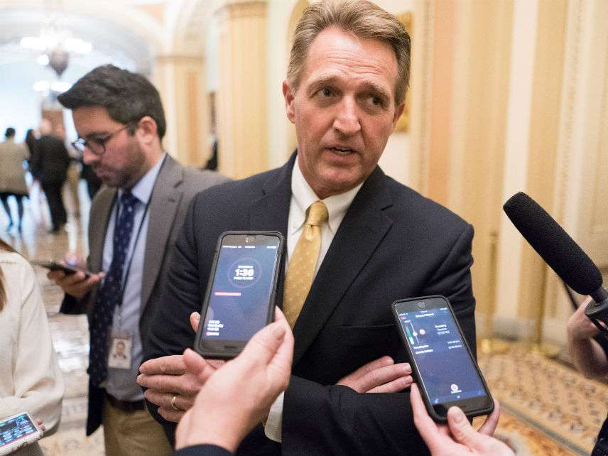 Jeff Flake talks to reporters. And talks to reporters…. ||| ERIN SCHAFF/UPI/Newscom