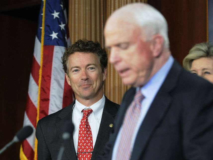 Rand Paul smiles as John McCain mistakenly refers to him as a congressman in October 2011. ||| JONATHAN ERNST/REUTERS/Newscom