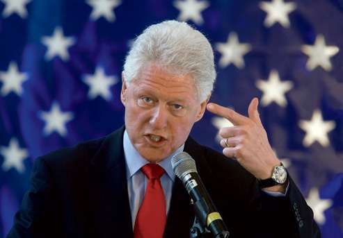 Clinton acts out his proposal to remake The Deer Hunter.