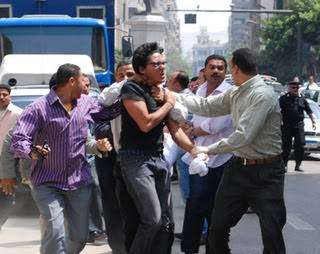 Ayman Nour being beaten to a pulp in better days.