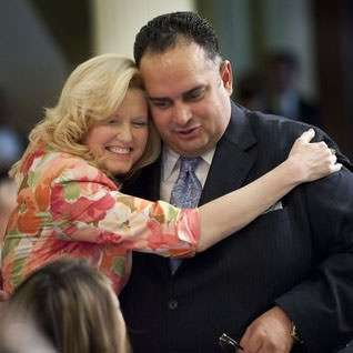 This is not a Biggest Loser group hug. It's Cathleen Gagliani and John Perez sharing a chaste but magical PDA.