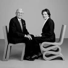 Eli and Edythe Broad appear uncomfortable while sitting on ugly furniture.