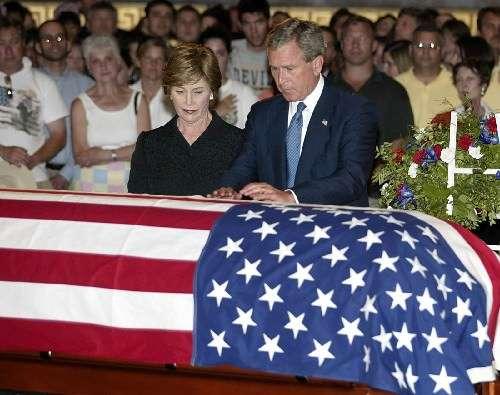 Hey guy at left: A t-shirt with a U.S.A. flag on it is still a t-shirt.