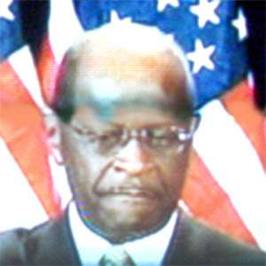 Herman Cain emphasizing his chin.