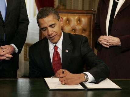 President Obama signs the Stimulus in 2009. Economic boom does not ensue.