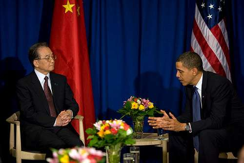 Supercilious Chinese guy looks down his snooty snoot at our president.