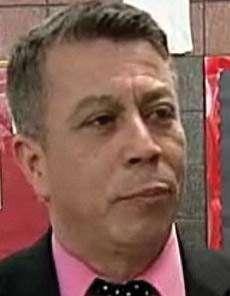 Principal Bill Jimenez should segregate those polka dots out of his tie.