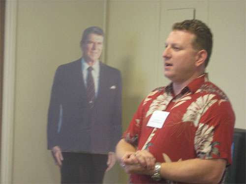 """A crudely doctored photograph shows the """"ghost"""" of Ronald Reagen haunting Republican John Stammreich."""