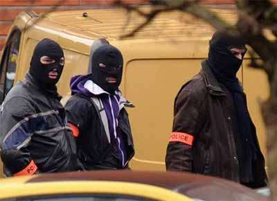 In the Twentieth Century the terrorists wore balaclavas and the cops didn't.