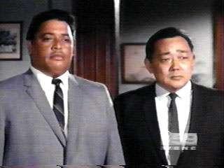 Big men in suits.